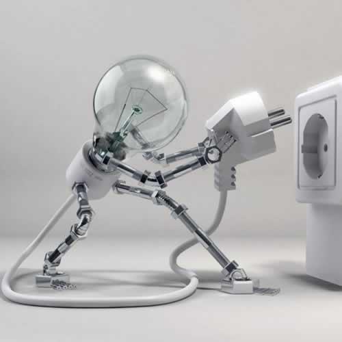 electric lightbulb plugs itself into an electrical socket